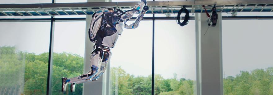 Обложка: Boston Dynamics научила роботов паркуру. Они одновременно сделали сальто назад — посмотрите сами
